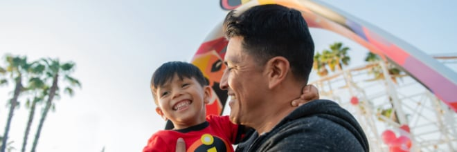 Dad and son next to Incredicoaster